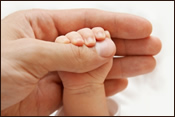 Infant Hand Reaching Out